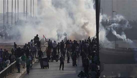 Morsi and Muslim Brotherhood supporters clash with security forces